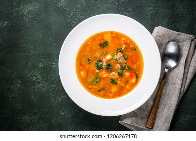 Traditional Hungarian goulash soup on the table. European cuisine. Top view with copy space.
