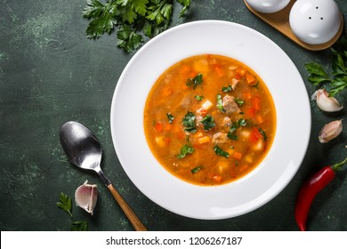 Traditional Hungarian goulash soup on the table. European cuisine. Top view with copy space,