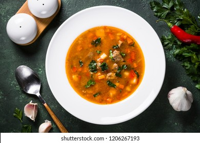 Traditional Hungarian goulash soup on the table. European cuisine. Top view.