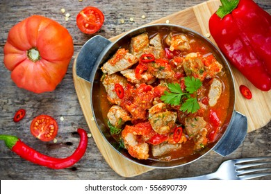Traditional hungarian paprikash - chicken pork or beef goulash stew with paprika tomatoes garlic chilli and sour cream