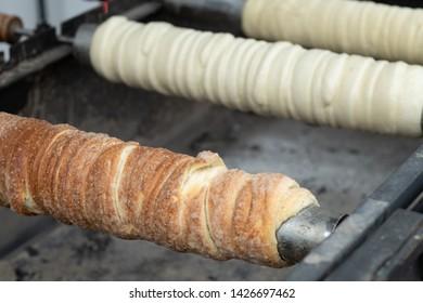 Traditional Hungarian street food. Homemade kurtosh kolac. Homemade trdelnik.