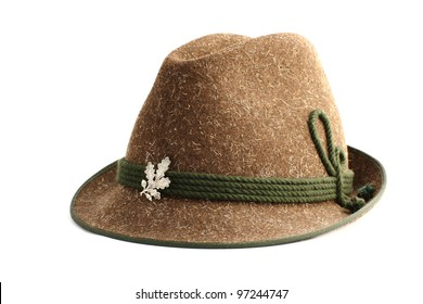 traditional hunting  hat made from natural sheep wool and decorated with a silver badge over white background