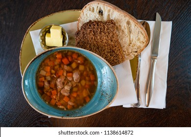 Traditional Icelandic lamb soup, bread and butter, summer time, indoor, Iceland