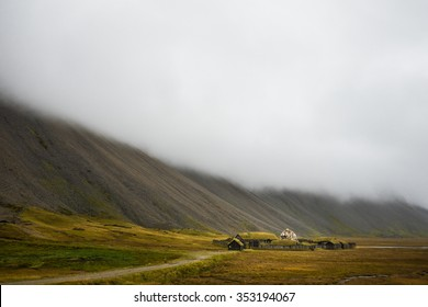 Traditional icelandic viking skyfall village. Wooden houses near mountains. Skyfall.