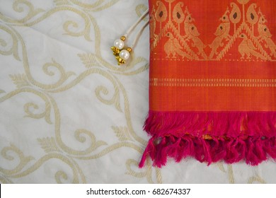 traditional indian background with vintage saree and pearl ornament for wedding, invitations and greetings.