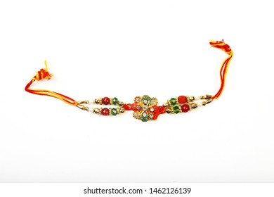 Traditional Indian Bracelet Calls Rakhi On White Background, Sister Ties On Brothers Wrist on the Ocassion of Rakshabandhan