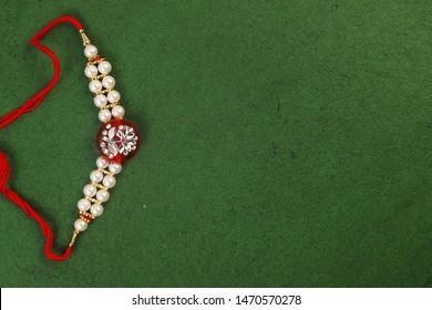 Traditional Indian Bracelet Calls Rakhi, Sister Ties On Brothers Wrist on the Ocassion of Rakshabandhan