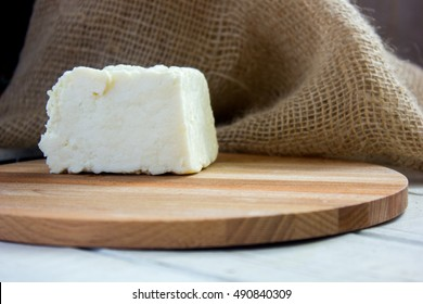 Traditional indian cheese panneer prepared from fresh milk on wooden board