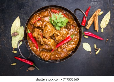 Traditional Indian curry lamb masala as close-up in a Korai