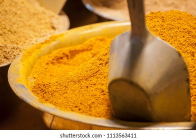 Traditional Indian curry powder spice mix in a bowl stock image. This spice blend is made of coriander, turmeric, cumin, fenugreek, and chili peppers. Sweet and aromatic Oriental spices.