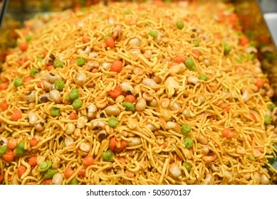 Traditional Indian Deep fried salty dish - chivda or mixture  or farsan or dal moth made of gram flour and mixed with dry fruits. Mix Namkeen diwali snack/food