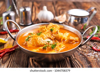 Traditional Indian dish chicken. Spicy chicken curry in bowl
