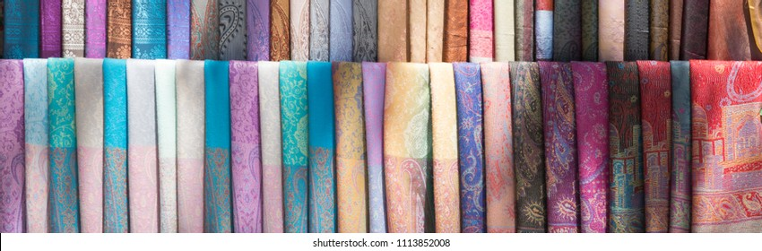 Traditional Indian fabric store. Colorful traditional indian hindi textile fabric shawls scarfs.