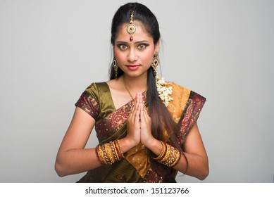 traditional indian female giving greetings during diwali