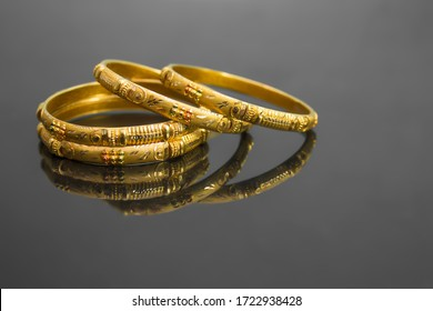 "traditional indian gold bangles, also known as ""sone ka Kada"" or ""sone ka kangan"" - Shutterstock ID 1722938428"