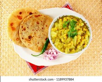 traditional indian gujarati  food dudhi chana curry shak stew recipe with roti or bhakhri or chapati