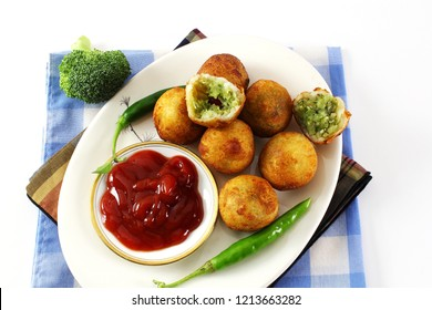 traditional indian gujarati food vegetable stuffed balls patties or pakoda kachori with tomato sause