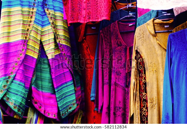 Traditional indian handmade clothes on the flea market in New Delhi, India.