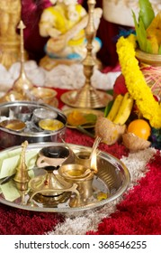 Traditional Indian Hindu religious praying items in ear piercing ceremony for children. Focus on the oil lamp. India special rituals events.