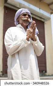 Traditional Indian man hands together - NEW DELHI; INDIA - MAY 17TH 2015