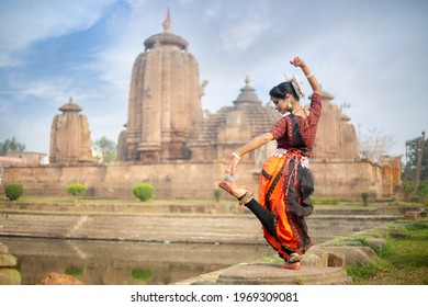Traditional Indian Odissi dance posing at temple. Indian dance odissi
