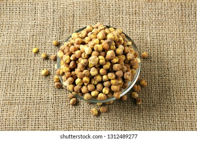 traditional indian roadside street snack food roasted chickpea nut or gram chana isolated on jute background