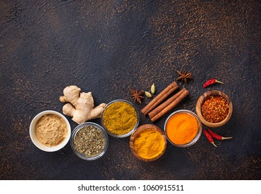 Traditional Indian spices. Turmeric, chili pepper, curry ginger and saffron