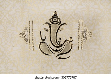 a traditional indian wedding invitation card - colorful, textured ,bold and beautiful well decorated embossed with lord ganesha and a sanskrit shloka