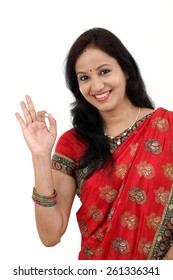 Traditional Indian woman against white background