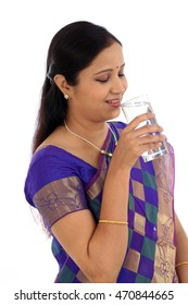 Traditional Indian woman drinking glass of water water