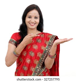 Traditional Indian woman showing open hand palm with copy space for product