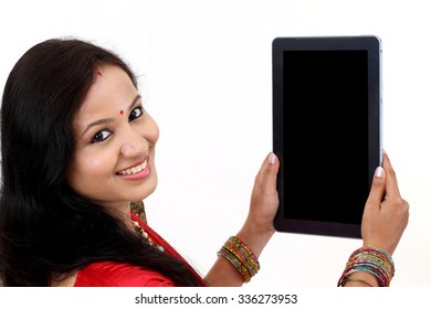 Traditional Indian woman using a tablet computer