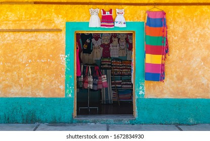 Traditional indigenous clothing shop with colorful facade in Santo Tomas Jalieza, Oaxaca state, Mexico.