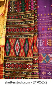 Traditional Indonesian batik embroidery in colorful motifs.