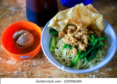 Traditional Indonesian Chicken Noodles with Crackers and Meatball Soup (Mie Ayam Bakso Ceker Pangsit Goreng)
