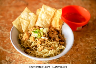Traditional Indonesian Chicken Noodles with Crackers and Meatball Soup (Mie Ayam Bakso Pangsit Goreng)