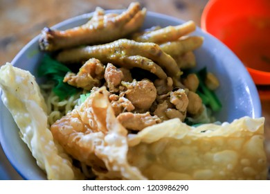 Traditional Indonesian Chicken Noodles with Chicken Feet, Crackers and Meatball Soup (Mie Ayam Bakso Ceker Pangsit Goreng)