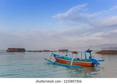 Traditional indonesian fishing boat at the Candidasa coast of Bali, Indonesia