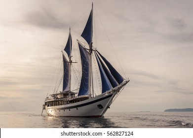 Traditional Indonesian Phinisi Schooner. The pinisi or phinisi is a traditional Indonesian two-masted sailing ship. These boats are made to ply the waters of the Indonesian archipelago.