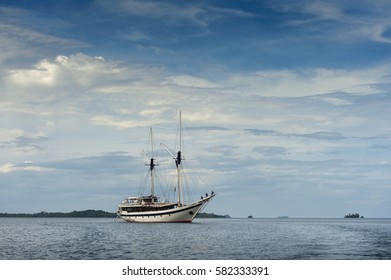 Traditional Indonesian Phinisi Schooner. The pinisi or phinisi is a traditional Indonesian two-masted sailing ship. These boats are made to ply the waters of the Indonesian archipelago in Raja Ampat.