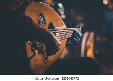 Traditional Instrument from Middle East and Asia called Oud or Ud. A Musician Playing Note on Oud  - Shutterstock ID 1251045772