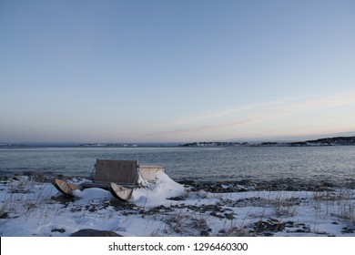 Traditional Inuit cargo sled or Komatik with a box on top and covered in snow, in the Kivalliq style, from Rankin Inlet, Nunavut, Canada