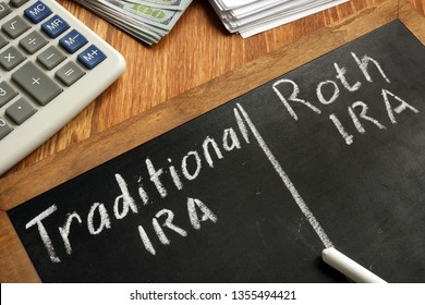 Traditional IRA vs Roth IRA written on blackboard.