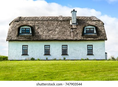 Traditional Irish country cottage house with thatch roof