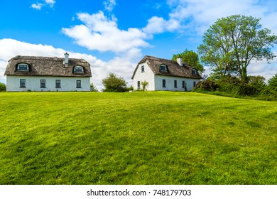 Traditional Irish country cottage houses with thatch roof.