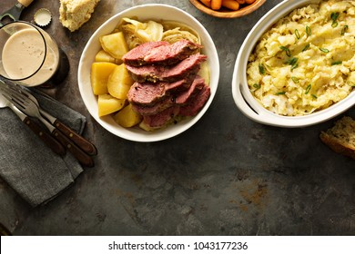 Traditional Irish dinner with corned beef, soda bread and colcannon overhead shot