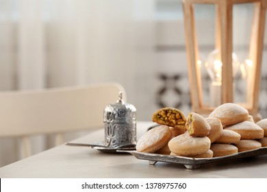 Traditional Islamic cookies on table, space for text. Eid Mubarak