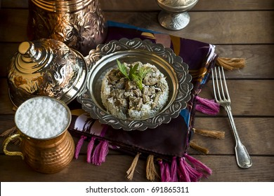 Traditional Islamic Feast, braised meat and rice on wooden table
