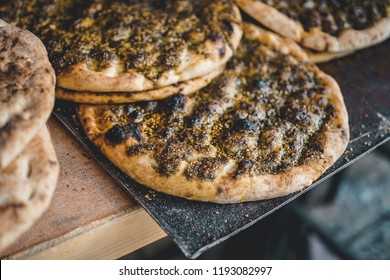 Traditional Israeli flatbread with zaatar close up on a market stall in Jerusalem, Israel. Horizontal food photo