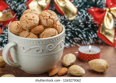 Traditional Italian almond cookies in a light Cup. Amaretti biscuits. Tasty treat for Christmas and New year. Selective focus